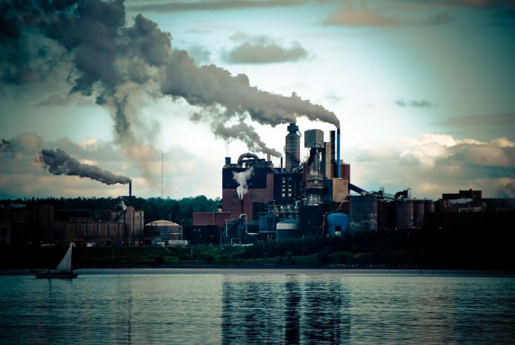 Photo of a factory creating pollution