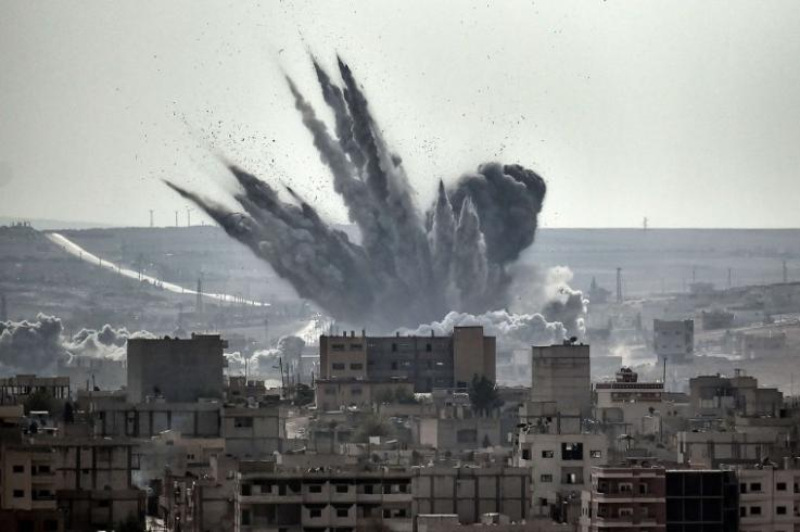 Photo of a shell exploding in Kobane, Syria