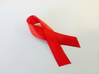 Image of a red ribbon, the universal symbol of awareness and support for people living with HIV