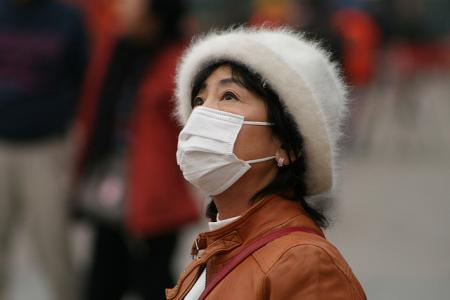 Woman wears a mask in China