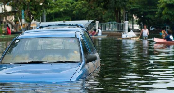 Blue Car Caught in Flood