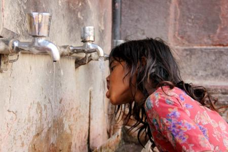 Photo of a child drinking water in India