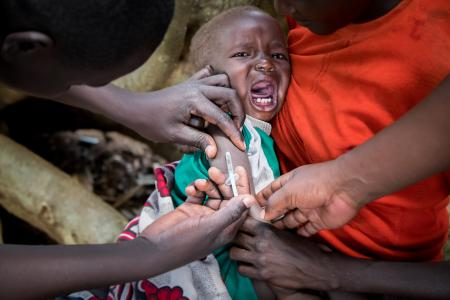 A child recieves a vaccine in Kenya.