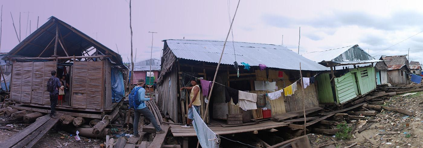 The research team doing an housing evaluation in a floating slum in Peru.
