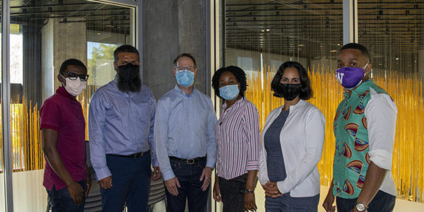 The inaugural class of the Doctor of Global Health Leadership and Practice program. From left to right: Eliud Akama, Anwar Parvez Sayed, Lee Pyne-Mercier, Phiona Marongwe, Raquel Sanchez, Stelio Tembe