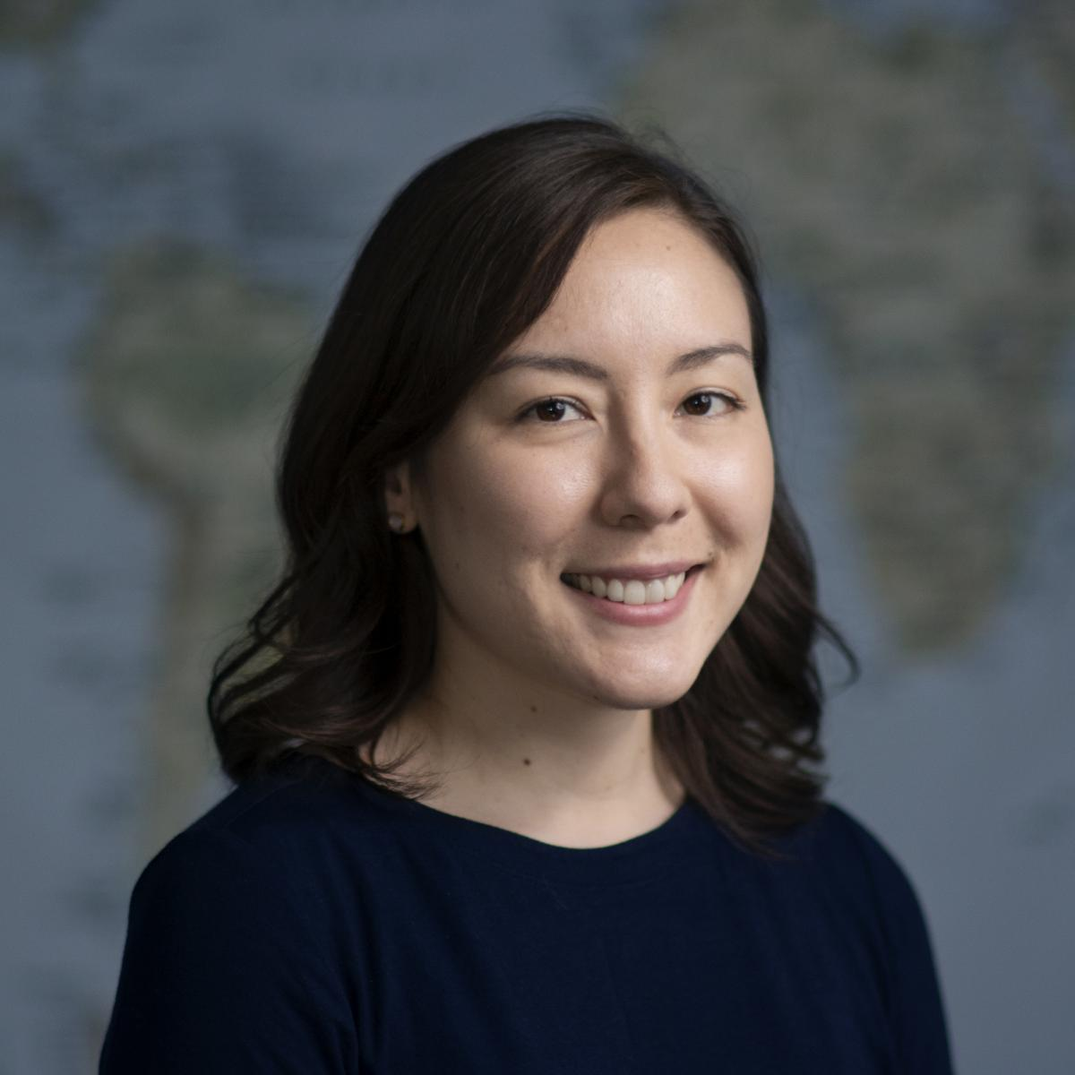 Profile photo of Stephanie Edlund-Cho in front of world map