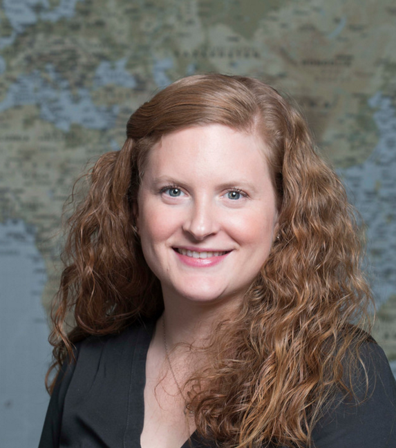 Profile photo of Mallory Erickson in front of world map