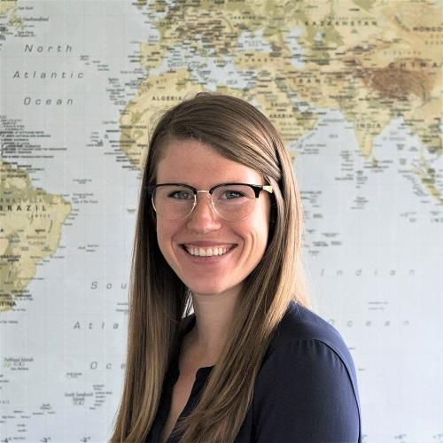 Profile photo of Tessa Concepcion in front of a world map