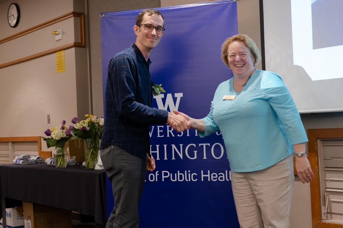 Christopher Kemp receives his award at the SPH Awards of Excellence
