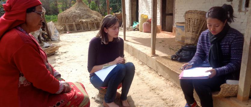 Photo of a student conducting verbal autopsy interviews in Nepal