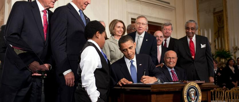 Photo of former President Barack Obama signing the Affordable Care Act
