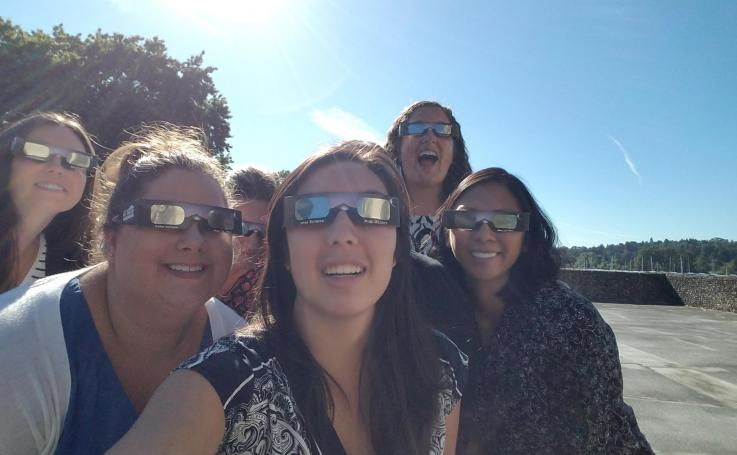 Staff watch the eclipse from Harris Hydraulics building in Seattle