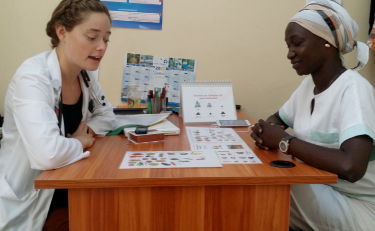 Photo of Sylvia counseling a social worker in Senegal
