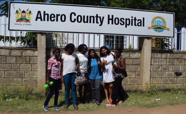 Photo of Rubee Dev and Shiza Farid with colleagues at the Ahero County Hospital in Kenya