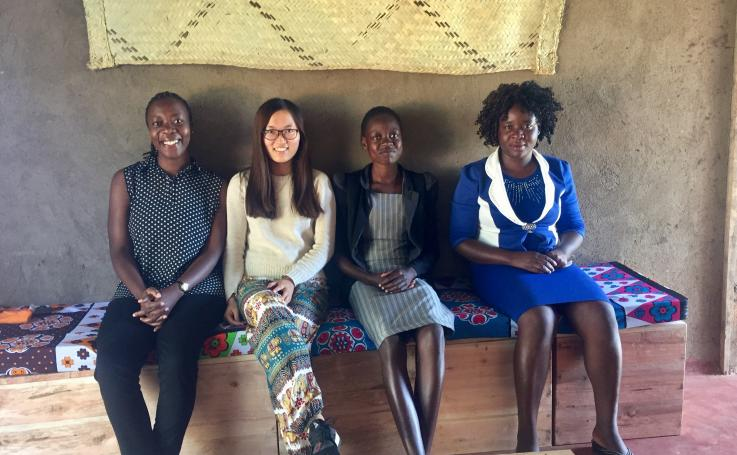 Photo of Yilin with health volunteers and community women in Kenya