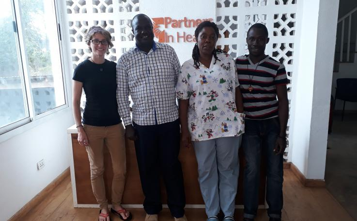 Photo of Katrin with her colleagues at Partners in Health in Liberia
