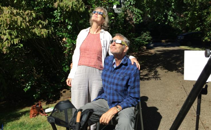Mary Anne Mercer and Steve Bezruchka watch the eclipse