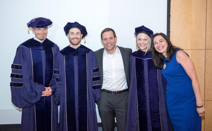 Photo of PhD faculty and graduates