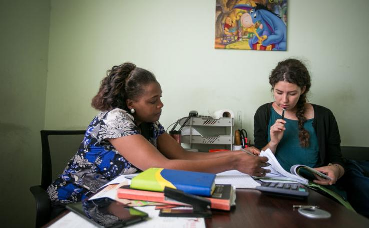 Photo of Zoë Cross reviewing patient files